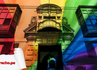 Fachada del TC con la bandera LGBT y logo de LP