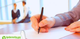 Persona firmando acta con logo de jurisprudencia registral y LP